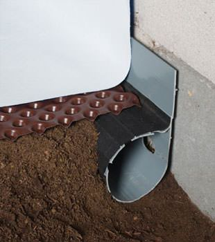 Closeup of a crawl space drainage system installed in Talbotton